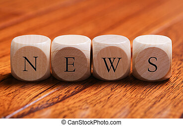 NEWS Word Concept - NEWS word wooden blocks are on the floor...