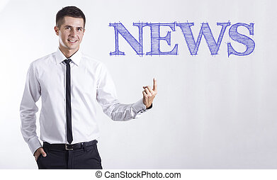NEWS - Young smiling businessman pointing on text