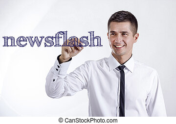 newsflash - Young smiling businessman writing on transparent surface