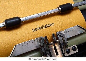 Newsletter text on typewriter