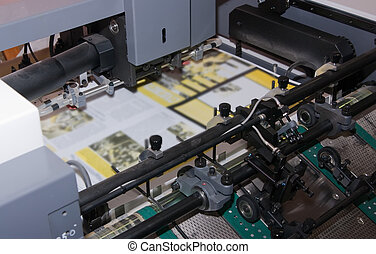 Newspaper at offset printed machine - pallet of paper at...