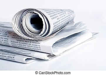 newspaper - pile of old newspaper on a white background