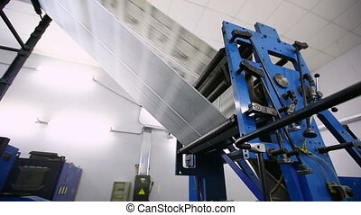 newspaper production line in print shop factory