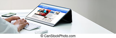 Newspaper Reading Online On Tablet Computer