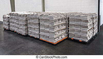 Newspaper Stacks On Pallets - Large number of newspaper...