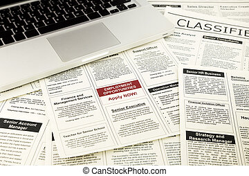 newspaper with advertisements and classifieds ads