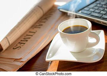 Newspaper with coffee