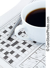 Newspapers and crossword puzzle on a white background