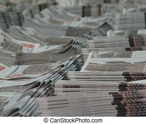 Newspapers rolls paper - Newspapers stacked and huge rolls...