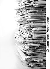 Newspapers - Pile of newspapers on plain background
