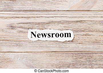 Newsroom of the word on paper. concept. Words of Newsroom on a wooden background