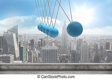 Newtons cradle above city