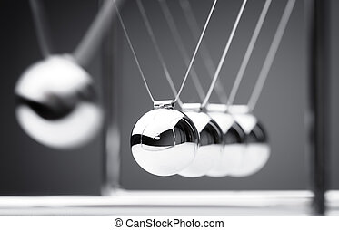 Newton's cradle physics concept for action and reaction or ...