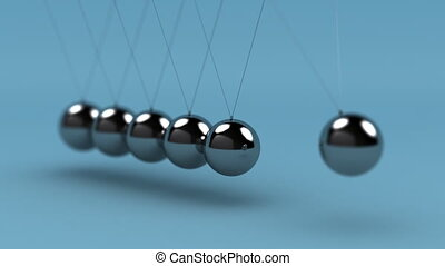 Close up of Newton's cradle with very shallow depth of field - seamless loop