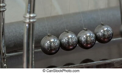 Newton's cradle showing laws of physics in motion. Museum of the Science and newton pendulum