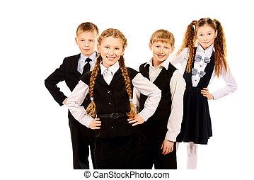 next generation - Group of cheerful schoolchildren standing...
