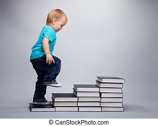 Next grade - A toddler climbing on a steps made of books