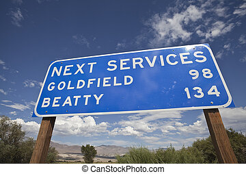 Next Services Sign in the Middle of Nevada