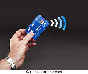 NFC - Contactless payment - Studioshot of payment action...