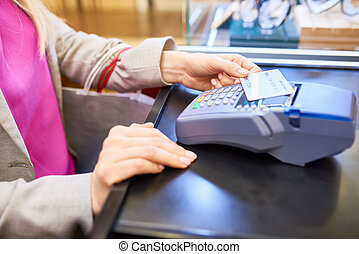 NFC Transaction - Closeup of unrecognizable young woman...
