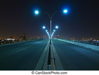 Nght bridge and towers - Empty bridge, towers and street...