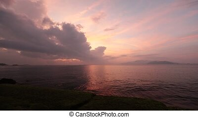 A hd movie clip of Nha Trang bay with a cloudy colourful morning sky with a calm sea.