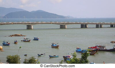 Many people and vehicles on the main bridge in Nha Trang city, Khanh Hoa, Vietnam.