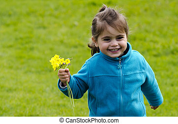 niña, asideros, flores amarillas