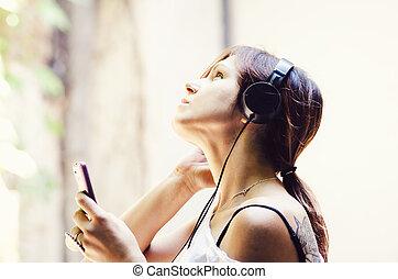 niña, con, auriculares