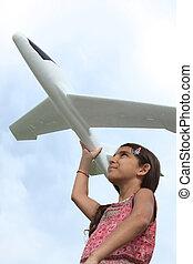 niña, con, avión modelo