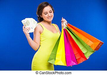 niña, con, compras, y, dinero