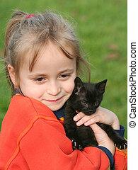 niña, con, gato