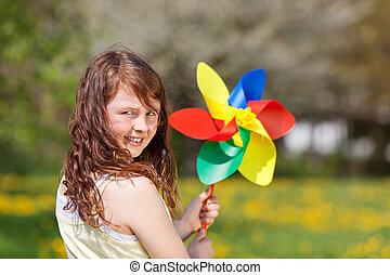 niña, con, juguete, molino de viento