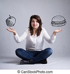 niña, con, un, dilema, sobre, alimento