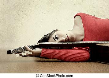 niña, con, un, guitarra