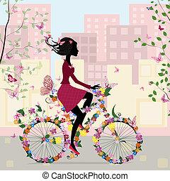 niña en una bicicleta, en la ciudad