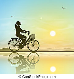 niña en una bicicleta