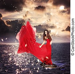 niña, en, vestido rojo, posición, en, océano, rocas