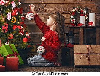 niña, es, decorar el árbol de navidad