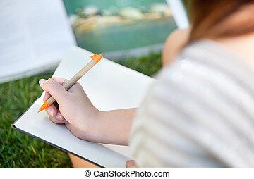 niña, escritura, en, un, cuaderno