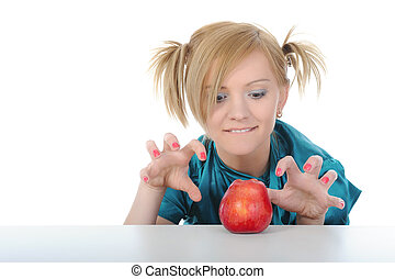 niña joven, con, un, manzana roja, en, el, mesa.