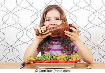 niña, pavo, grande, comida, pata de pollo, hambriento