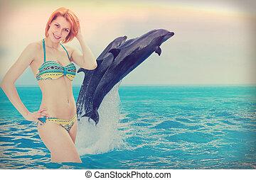 niña, playa, delfines