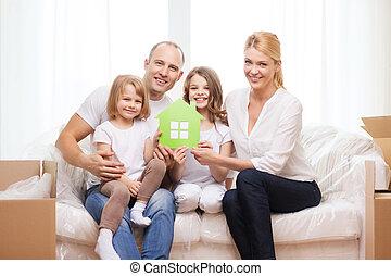 niñas, dos, padres, hogar, nuevo, sonriente