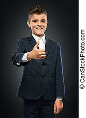 niño, actuación, arriba, negro, pulgares, traje