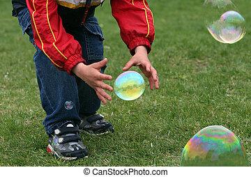 niño, con, burbujas