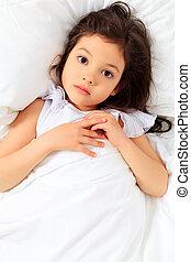 niño en cama