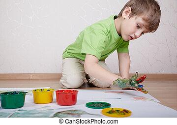 niño, en, el, verde, camiseta, empates, color, pinturas, con, el suyo, dedos, en, el, hoja de papel