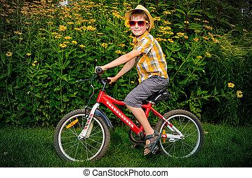niño, en una bici