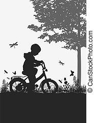 niño, en una bicicleta